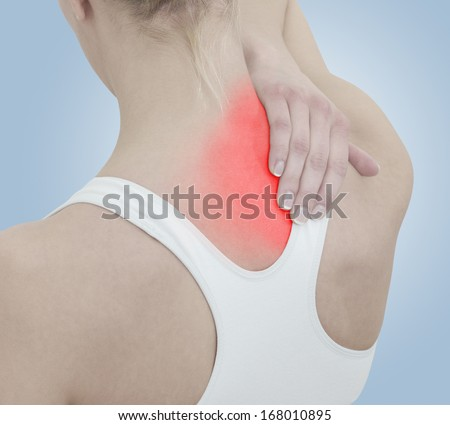 Acute pain in a woman neck. Female holding hand to spot of neck-aches. Concept photo with Color Enhanced blue skin with read spot indicating location of the pain.