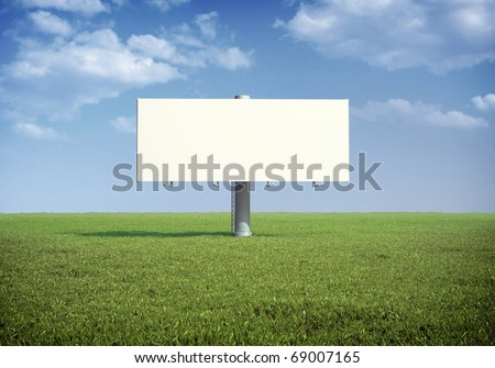 Ad billboard standing in a field of grass