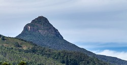 Adam's Peak tall conical mountain located in central Sri Lanka, rock formation near the summit, which in Buddhist tradition is held to be the footprint of the Buddha.