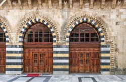 adana grand mosque, historic wooden doors and courtyard, ulucami
