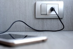 adapter for smartphone charging on wall outlet.