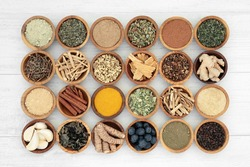 Adaptogen healthy food with herbs, spices, fruit and supplement powders. Natural plant based foods that help the body deal with stress and  promote or restore normal physiological functions.