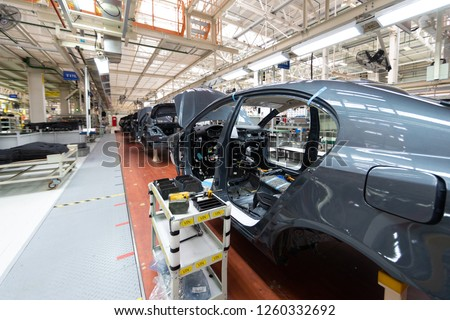 Add details to car body. Robotic equipment makes Assembly of car. Modern car Assembly at factory