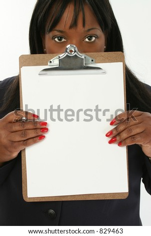 Add text.  Beautiful 29 year old African American business woman holding clipboard with blank page towards camera.