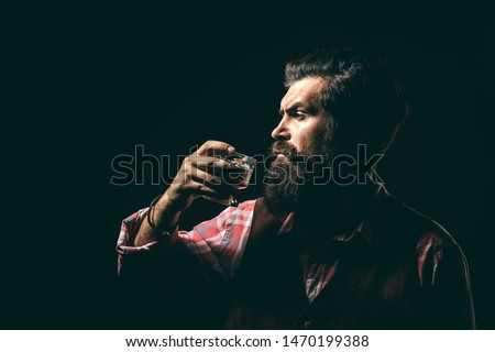 Addicting to alcoholic drink. Alcoholism. Handsome stressed businessman in formal wear holding a glass of whiskey in his hand. Stop alcohol addiction #1470199388