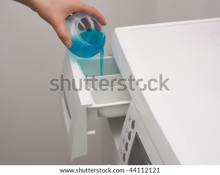Adding detergent to dispenser of washing machine