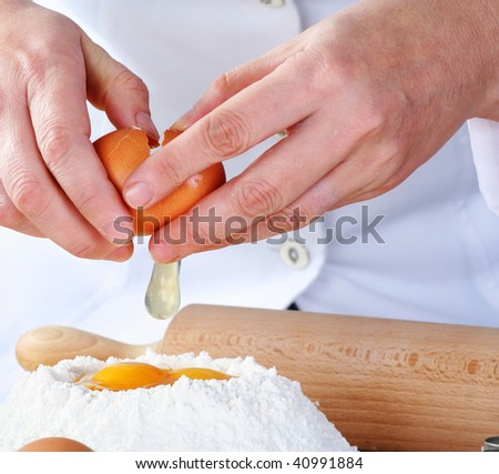 adding egg to the flour