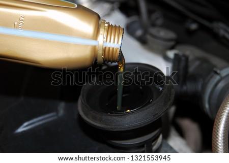 Adding Oil to a Car  #1321553945