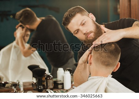 Adding some wax to the look. Horizontal shot of a barber giving a hairstyle to his client using hair wax ストックフォト ©