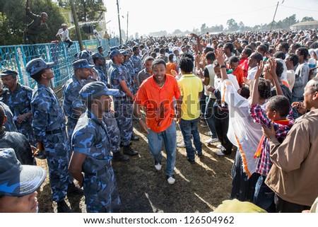 ADDIS ABABA, ETHIOPIA - JANUARY 19: Holy water sprayed on thousands of people attending Timket celebrations of Epiphany, commemorating the baptism of Jesus, on January 19, 2013 in Addis Ababa, Ethiopia.