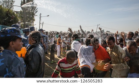 ADDIS ABABA, ETHIOPIA - JANUARY 19: Holy water sprayed on thousands of people attending Timket celebrations of Epiphany, commemorating the baptism of Jesus, on January 19, 2013 in Addis Ababa, Ethiopia.