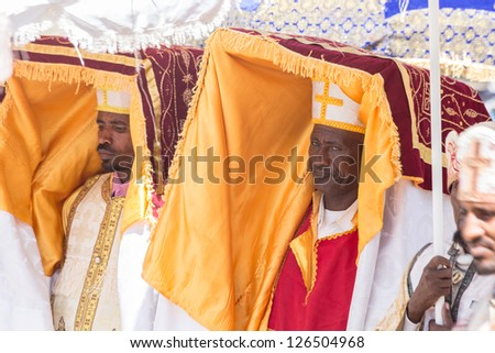 ADDIS ABABA, ETHIOPIA - JANUARY 19: Priests carry the Tabot, a model of the Arc of Covenant, during a colorful procession of Timket celebrations of Epiphany, on January 19, 2013 in Addis Ababa, Ethiopia.