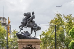 Adelaide's South African (or Boer War) Memorial monument with an airliner in the background, Southern Australia