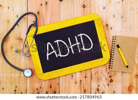 ADHD handwritten on blackboard medecine concept