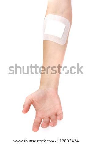 adhesive bandages on injury hand on white background