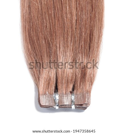 Adhesive tape in straight copper brown remy human hair extensions Photo stock ©