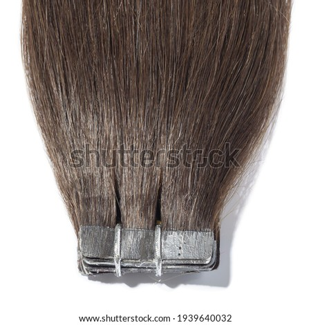 Adhesive tape in straight dark brown remy human hair extensions Photo stock ©
