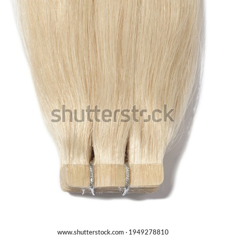 adhesive tape in straight golden bleached blonde human hair extensions Photo stock ©