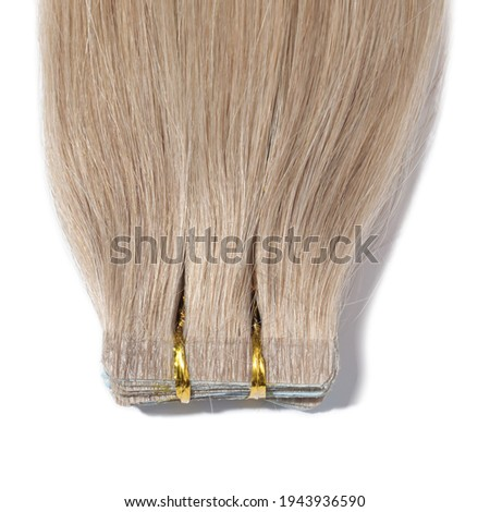 adhesive tape in straight honey blonde remy human hair extensions Photo stock ©