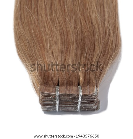 adhesive tape in straight honey brown remy human hair extensions Photo stock ©