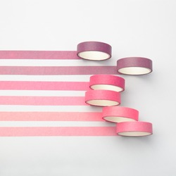 Adhesive tape rolls and parallel strips on white background