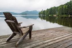 Adirondack chair on lake dock