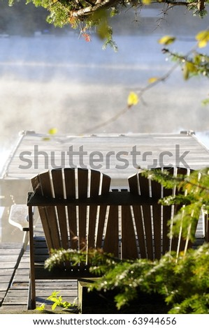 Adirondack Chairs on dock look out onto misty autumn lake water/Misty Autumn Morning/The Beauty of Autumn