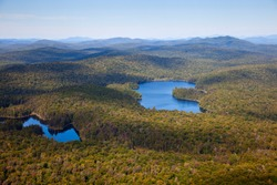 Adirondack forests and lakes summer aerial view from light aircraft cabin