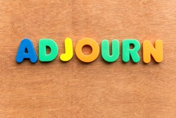 adjourn colorful word on the wooden background