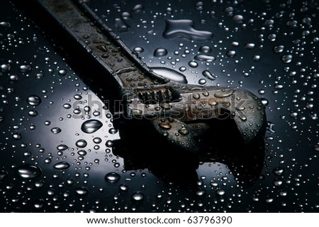 Adjustable spanner , water drops background , wrench,dramatic lighting - stock photo