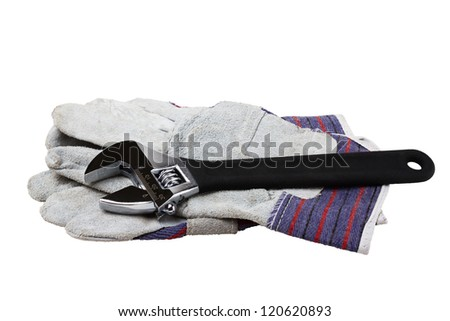 adjustable spanner with gloves isolated on white
