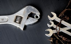 adjustable spanner with spanners and nut as barbed wire birds nest