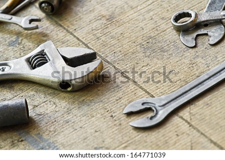 Adjustable wrench and tools for bike repairing