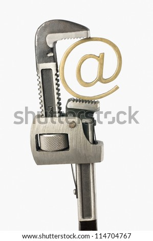Adjustable wrench with at symbol