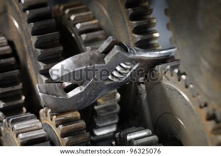 Adjustble spanner stuck between cog gear wheels.