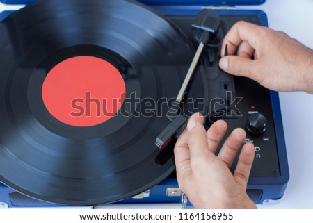 adjusting the volume of the turntable #1164156955