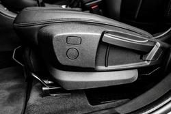 Adjustment car seat. Manual adjusting levers for adjusting seat position.