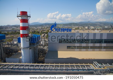ADLER, RUSSIA - JUNE 26, 2013: Gazprom company logo on the roof of thermal power plant. #191050475