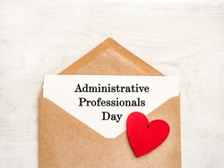 Admin Day Greeting Card. Close-up, view from above, wooden surface. Concept of preparation for a professional holiday. Congratulations for relatives, friends and colleagues