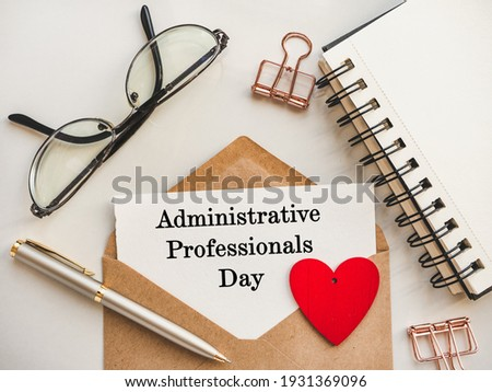 Admin Day Greeting Card. Close-up, view from above, wooden surface. Concept of preparation for a professional holiday. Congratulations for relatives, friends and colleagues Сток-фото ©