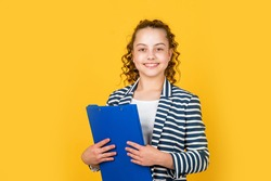Administrative. Coordinator and project management. Library assistant. Happy girl hold library folder. School library. Knowledge and information. Student teen formal style. Education concept.