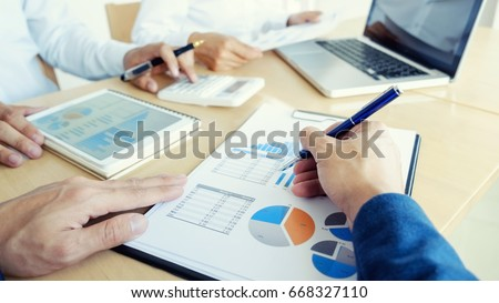 Administrator business man financial inspector and secretary making report, calculating or checking balance. Internal Revenue Service inspector checking document. Audit finance concept. #668327110