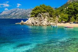 Admirable bay with moored motorboats and wonderful beach, Brela, Dalmatia, Croatia, Europe