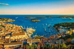 Admirable view from the hill with spectacular cityscape and fantastic harbor at sunset, Hvar, Dalmatia, Croatia, Europe