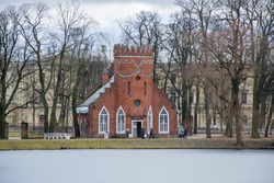 Admiralty brick tower pavilion in Catherine park at Tsarskoe Selo in warm winter. Pushkin town. Saint Petersburg. Russia.