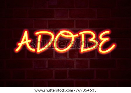 ADOBE neon sign on brick wall background. Fluorescent Neon tube Sign on brickwork Business concept for Software Company Name 3D rendered #769354633