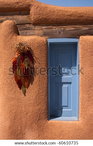 Adobe shuttered window at Rancho de Taos in New Mexico