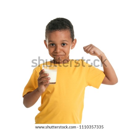 Adorable African-American boy with glass of milk on white background