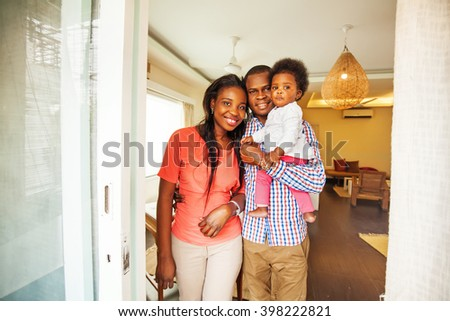 adorable african family in their home
