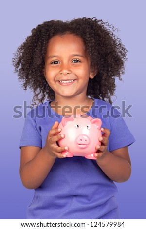 Adorable african little girl with piggy-bank isolated over blue background